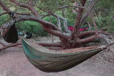 Camping Hammocks Are Durable, Comfortable, And Amazingly Portable, Many  Weighing Less Than A Pound. Parachute Nylon Reaches Its Finest Expression  Between ...
